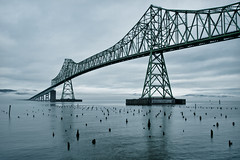Water under the bridge (Dan Mihai) Tags: morning bridge water fog clouds oregon washington day cloudy columbiariver astoria pacificnorthwest pilings megler splittone astoriabridge trussbridge pointellice