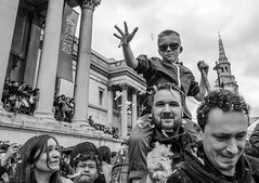 Hi Five DSC_3809.jpg (Sav's Photo Gallery) Tags: street city uk travel portrait people london westminster smile smiling photography capital crowd feathers streetphotography trafalgarsquare tourist nationalgallery pillow gb pyjamas pillowfight soundasleep d7000 savash