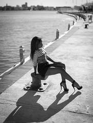 Girl on the Quay (mugensx) Tags: light shadow sun white black sexy water girl pose 50mm pier back high skin f14 sony leg sigma quay heels alpha dslr 5014 a900