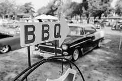 BBQ (AndreasGarcia) Tags: ca blackandwhite bw usa film monochrome sign analog 35mm photography dof bokeh bbq depthoffield classiccars carshow porterville canonefm originalphotography bokehlicious