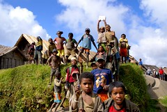 Kids showing off their school equipment in a remote Madagascar village (galdo trouchky) Tags: poverty voyage school smile childhood kids rural pencil children photography education village joy culture books pride pens curiosity madagascar isolated cultural encounter secluded coutryside