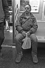 Man on the train with a bag of chocolates,  Feb. 14 2012 (allicette) Tags: new york city nyc white black manhattan valentines 2012 torres allicette