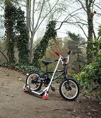 –––––– (Brian Luman) Tags: park newyorkcity sculpture newyork nature bike centralpark manhattan brian scooter trainingwheels luman brianluman