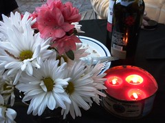 spring evening (Just Back) Tags: camera flowers red white sc birds daisies dinner table outside evening spring bottle picnic candles quiet wine scene columbia flame bloom wax azalea twittering