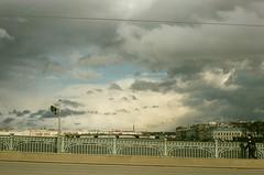 Trininty Bridge after the rain (OlmecaG) Tags: city bridge sky film architecture clouds 35mm cityscape russia saintpetersburg saintp