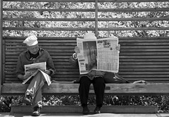Sunday Papers (cjimhow) Tags: people bw monochrome vancouver canon bench reading blackwhite sitting bc newspapers queenelizabethpark cjimhow colinhowarth