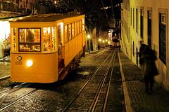 Downhill Uphill (parkerbernd) Tags: old travel vacation portugal beauty night lumix lights ancient lisbon tram downhill historic panasonic da uphill ascensor elevador glória gx1