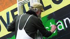 painting love 03 (byronv2) Tags: street man colour art church painting scotland orlando rainbow mural edinburgh paint colours candid lgbt painter ladder newtown rainbowflag peoplewatching gayrights saintjohns saintjohnschurch