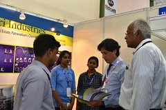 Mr. Sher Verick, Deputy Director, ILO New Delhi visiting a SCORE trained enterprise stall in the ACMEE exhibition (ILO in Asia and the Pacific) Tags: india norad seco smes employment working conditions social dialogue