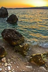 Crocodile Beach Sunset (stumpyheaton) Tags: blue sunset sea sky sun seascape beach water yellow photoshop outside island hotel islands spain sand nikon rocks day waves lass greece crocodile ionian argostoli d5100