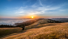 Sunset on the Pacific (Juan Sebastian Elcano) Tags: california road blue sunset sea orange usa sun mountain sol yellow azul clouds rural atardecer gold golden bay us carretera pacific nubes montaa pacifico dorado road1 freeway1