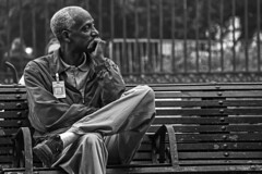 Thinking (Lea Duckitt) Tags: street new sunset vacation people usa white holiday man black male monochrome america mississippi bench square french orleans solitude thought alone afternoon united think jazz jackson sit stare quarter rest lonely states listen