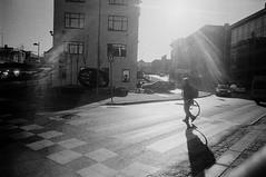 Solheimsviken (varjagg) Tags: leica woman bicycle wheel norway lens crossing kodak tmax 28mm pedestrian flare cogwheel bergen february cog m4 2012 xtol f6 kmz ei1600 p3200 p3200tmz orion15
