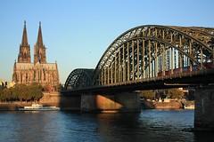 Cologne Cathedral and Hohenzollern Bridge at sunrise (fotoeins) Tags: travel bridge sky heritage sunrise canon river germany geotagged deutschland eos dawn europa europe day cathedral dom kitlens cologne kln unesco rhine rhein koeln unescoworldheritage nordrheinwestfalen worldheritage xsi northrhinewestphalia hohenzollernbruecke hohenzollernbrcke eos450d henrylee 450d canonefs1855mmf3556is fotoeins henrylflee geo:lat=5094042419761927 geo:lon=6968510151541523 fotoeinscom