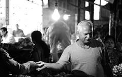 Change (recaptured) Tags: street monochrome bulb blackwhite market buy customer desaturated bazaar sell groceries mandai 55200mm gettyimagesindiaq4 lpcustomer
