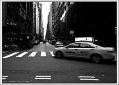 44th Street (Jeff_B.) Tags: city nyc newyorkcity urban bw motion streets manhattan taxi midtown traffice