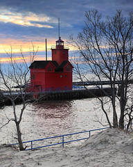 Holland Harbor Lighthouse - Known as (Big Red) Holland, Michigan (Michigan Nut) Tags: trees winter sunset red sky usa reflection beach nature clouds geotagged photography sand midwest michigan scenic landmark lakemichigan bigred johnmccormick hollandlighthouse michigannutphotography