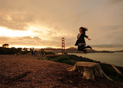 Jump for  J O Y ! (.OhSoBoHo) Tags: sunset selfportrait me self canon fun joy wideangle moi io 1022mm presidio whee treestump selfie crissyfields valuable themeoftheweek mise jumpforjoy totw canoneos40d goldengatebridge75thanniversary meagainmonday jumpgoldengatebridge