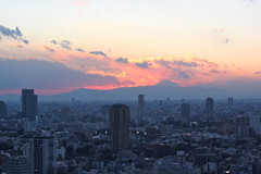 Mt. Fuji sunset from Tokyo Tower (kevin dooley) Tags: city eve sunset red sky urban orange building tower japan canon dark landscape japanese 50mm tokyo fuji mt shot dusk 14 tokyotower mtfuji urbanlandscape ligh citiscape concretejungle 40d mtfujisunset toykosunset sunsetfromtoykotower