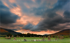 Castlerigg at Sunrise - Keswick - Lake District - England (~ Floydian ~ ) Tags: longexposure greatbritain morning light england cloud sun mountain mountains colour colors clouds sunrise canon circle landscape moving ancient rocks warm mood glow colours view unitedkingdom stones postcard lakedistrict warmth atmosphere cumbria postcards morningglory viewpoint keswick meijer henk skiddaw castlerigg blencathra lonscalefell floydian proframe proframephotography leefilters canoneos1dsmarkiii henkmeijer