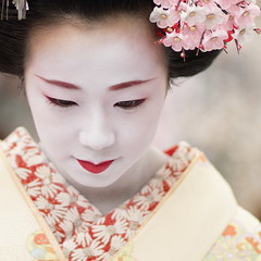 The maiko (geisha apprentice) Satohina /   / Kyoto, Japan (momoyama) Tags: travel winter red portrait people woman white flower colour girl beautiful beauty face yellow festival japan canon hair photography japanese photo dance costume kyoto asia day traditional culture makeup 85mm lips maiko geiko geisha 7d kimono baikasai ef85mmf18 kanzashi