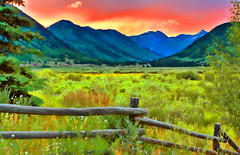 Meadows and Mountains (jackaloha2) Tags: sunset mountains fence colorado meadows rockymountains wildflowers crestedbutte valleys wildgrasses colorphotoaward happyfencefriday photoshopcs5 ringexcellence