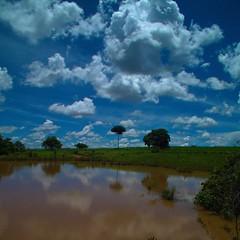 I love the clouds (gildofellipe) Tags: blue brazil sky cloud lake reflection nature water gua azul brasil clouds landscape fuji cloudy natureza paisagem nuvens fujifilm nuvem ceu hs20exr