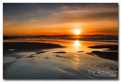 Gwithian sunset - Explore #146  16/03/12 (Simon Bone Photography) Tags: sea sky cloud sun reflection beach silhouette sand cornwall gwithian cornishcoast cokinnd8grad cornishsunsets wwwthehidawaycouk canoneos7d canonef24105mmlf4