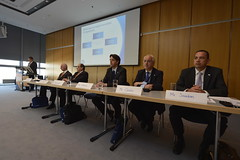 Panellists listen to Gunter Zimmermeyer's address