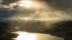 Sunfall on The Trossachs (J McSporran) Tags: sunset landscape scotland sunburst sunbeam trossachs benvenue benaan lochvenacher