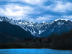 Dark clouds were gathering over the mountains (Angel Christine) Tags: blue sky white mountain lake snow nature fog clouds landscape scenery long exposure air cielo  landschaft
