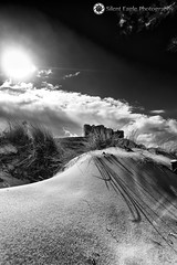 Castle Bamburgh, Northumberland (Silent Eagle  Photography) Tags: bw plants sun castle beach monochrome beautiful weather clouds canon photography yahoo google ray shadows silent eagle northumberland sep northeast bamburgh canoneos5dmarkiii