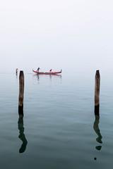 Rowing In The Mist (MaxSkyMax) Tags: venice red italy mist reflection canon italia lagoon gondola ripples poles laguna rossa