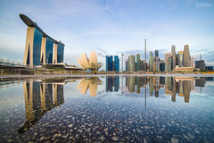Nature's Mirror (hak87) Tags: city morning reflection water skyline museum marina sunrise puddle dawn bay singapore sands mbs artscience