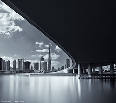 Curvaceous (DanielKHC) Tags: bridge water bay nikon long exposure dubai cityscape uae business khalifa nik curve hdr burj d300 nd400 tokina1116mmf28 silverefex photoengine oloneo