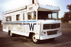 W - RV (Nick Leonard) Tags: nick nickleonard needles california route66 roadtrip outdoors outside winter morning vehicle auto transportation vintage retro old classic rv motorhome white wheels windows doors yashica yashicat4 carlzeiss tessar 35mm 35mmfilm film colorfilm kodak kodakfilm kodak400uc 400asa expiredfilm expired2009 scan epson4490 believeinfilm bus