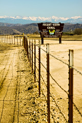 not on any day (thermophle) Tags: california foothills mountains fence canal sierra kern dirt fresno friant