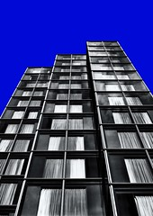 London-Architecture-No.7-Blue (Fifty Percent Grey) Tags: uk white black colour london architecture canon grey mono europe pattern britain geometry line explore series block form secondary 1855 shape juxtaposition primary tone solid juxtaposed andle 450d unitedkingtom