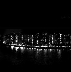 suburb living (Chez C.) Tags: voyage city cruise sea vacation white holiday black reflection monochrome 50mm lights star ship cityscape olympus line hong kong string moment pisces lineup