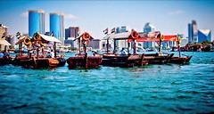 Dubai Creek (miemo) Tags: travel river boat dubai skyscrapers traffic uae middleeast olympus abra arabia dubaicreek unitedarabemirates ep1 tiltshift burdubai faketiltshift