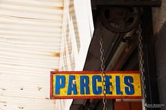 Parcels (Lauren Barkume) Tags: africa blue red sign yellow southafrica parcels photowalk artdeco johannesburg joburg 2012 gauteng johanesburg eastrand photowalkers laurenbarkume gettyimagesmeandafrica1