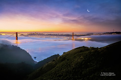 San Francisco's Dreams (Darvin Atkeson) Tags: ocean sanfrancisco city bridge moon seascape tower beach skyline skyscraper sunrise landscape bay nikon glow venus pacific foggy goldengatebridge moonrise goldengate citylights baybridge coit kirbycove d300 citybythebay darvin atkeson darv liquidmoonlightcom