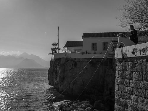 travel blackandwhite bw woman turkey fishing antalya coastline alexberger virtualwayfarer