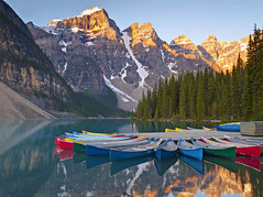 Sunrise on Moraine Lake - 2006 (Matt Champlin) Tags: life morning travel canada mountains tourism alaska sunrise wow rockies amazing rainbow colorful jasper olympus canoe glacier canoes alberta boating banff lakelouise incredible ontheroad tranquil moraine jaspernationalpark banffnationalpark glacial canadianrockies coolblue valleyofthetenpeaks coolpicture columbiaicefieldsparkway sunrisemorainelake canoesonmorainelake glacicallakes