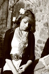 Sadness overruns any good day (Toytography) Tags: park winter light portrait white black cold flower brick philadelphia girl sunshine stone sepia canon lens eos rebel is waiting december day afternoon natural boots area 1855mm xs colder pennsylvaina 1000d