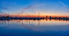 St Petersburg Sailboat Sunrise (Photomatt28) Tags: reflection water sailboat sunrise stpetersburg boats dawn pier airport florida nik hdr controltower topaz albertwhittedairport oloneo
