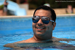 Happy in the Pool (Meshari Al-Rezaihan) Tags: blue summer portrait people sun holiday pool face sunglasses canon happy weekend egypt resort swimmingpool summertime 550d sharmelshaikh meshari lens18200mm eos550d alrezaihan