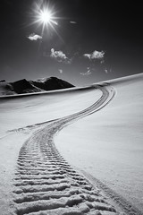 Tracks (Wolfhorn) Tags: sun snow alaska blackwhite alone tracks wilderness springtime