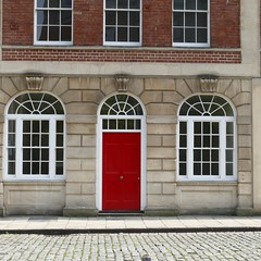 The RED door (forkcandles) Tags: red england white building brick glass stone architecture buildings bristol pavement arches fz1000 forkcandles may2016 fz1000panasoniccamera