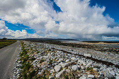 Isolation (Costigano) Tags: road ireland sea sky irish seascape clouds canon landscape eos coast seaside rocks clare atlantic shore burren